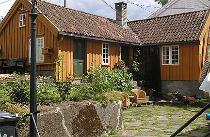 This Summer Mountain Retreat In Lillesand Norway Has Been Painted Antique Gold The Durability Of Paint Fully Tested Under Extremes